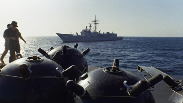 FILE - This Sept. 21, 1987 file photo shows mines aboard the Iranian ship Iran Ajr being inspected by a boarding party from the USS Lasalle in the Persian Gulf. (Mark Duncan / AP)