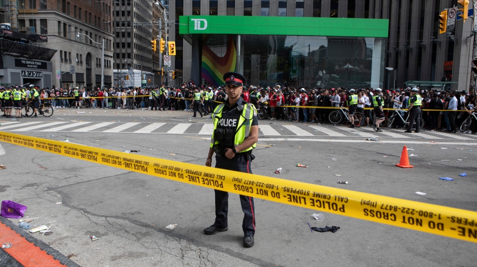 Police stand in a cordoned off area of Queen and Bay in Toronto on Monday June 17, 2019 after a shooting incident took place in the proximity of the Toronto Raptors victory parade. THE CANADIAN PRESS/Chris Young