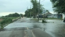 Water runs over Erie Shore Drive in Chatham-Kent, (Courtesy Trevor Thompson / Facebook)