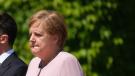 Merkel blames dehydration for shakes during anthem
