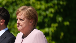 Merkel blames dehydration for shakes during anthem