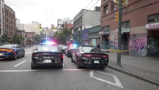 Police respond to an assault in Vancouver's Downtown Eastside that put one person in hospital on June 17, 2019.