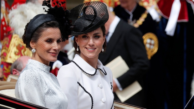 Spain's Queen Letizia and Britain's Kate, the Duchess of Cambridge leave the Order of The Garter Service at Windsor Castle in Windsor, Monday, June 17, 2019. (AP Photo/Frank Augstein, Pool)