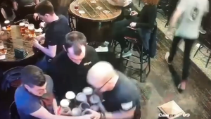 Irish waiter spills tray of beer twice