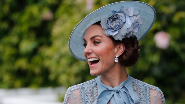Kate, Duchess of Cambridge, smiles upon her arrival on the day one of the annual Royal Ascot horse race meeting in Ascot, England, Tuesday, June 18, 2019. (AP Photo/Alastair Grant)
