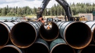 Pipe for the Trans Mountain pipeline is unloaded in Edson, Alta. on Tuesday, June 18, 2019. THE CANADIAN PRESS/Jason Franson