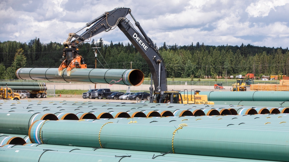 Pipe for the Trans Mountain pipeline is unloaded