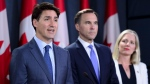 Prime Minister Justin Trudeau makes an announcement regarding the government's decision on the Trans Mountain Expansion Project with Minister of Environment and Climate Change Catherine McKenna and Minister of Finance Bill Morneau, in Ottawa on Tuesday, June 18, 2019. THE CANADIAN PRESS/Sean Kilpatrick