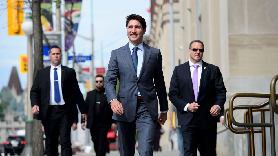 Prime Minister Justin Trudeau makes his way to make an an announcement regarding the government's decision on the Trans Mountain Expansion Project in Ottawa on Tuesday, June 18, 2019. THE CANADIAN PRESS/Sean Kilpatrick