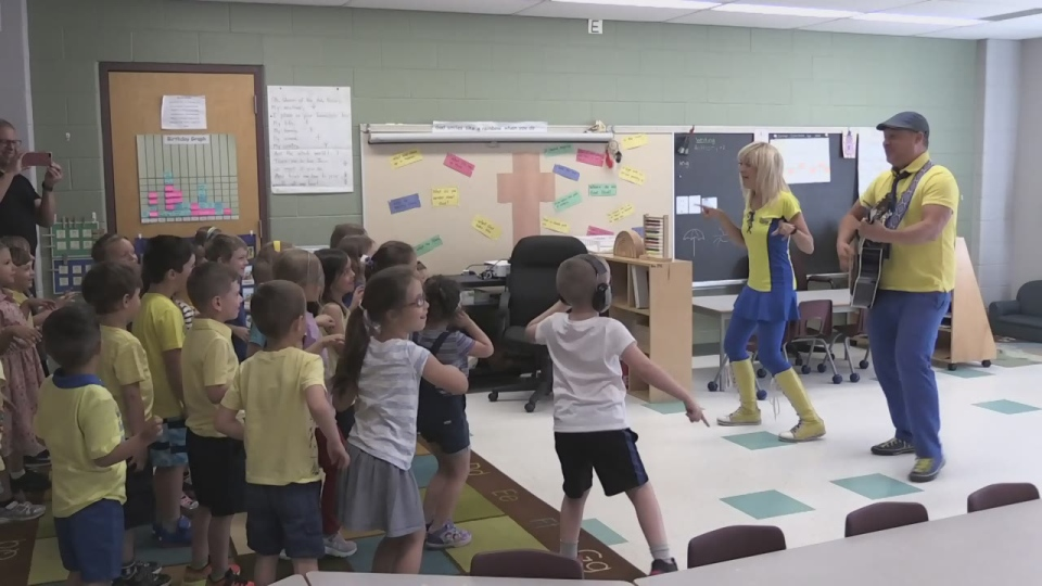 Splash n' Boots, a children's musical duo, visit St. Michael's the Archangel Catholic School in Barrie on Tues., June 18, 2019 (CTV News/Rob Cooper)