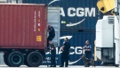 Authorities search a container along the Delaware River in Philadelphia, Tuesday, June 18, 2019. (AP Photo/Matt Rourke)