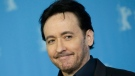 """Actor John Cusack poses for photographers, during a photocall for the film 'Chi-Raq"""", at the 2016 Berlinale Film Festival in Berlin, Tuesday, Feb. 16, 2016. (AP Photo/Michael Sohn)"""