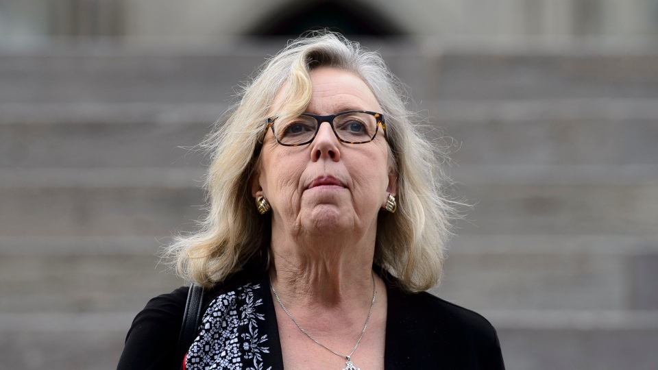 Green Party leader Elizabeth May makes her way from Parliament Hill in Ottawa on Tuesday, June 18, 2019. THE CANADIAN PRESS/Sean Kilpatrick