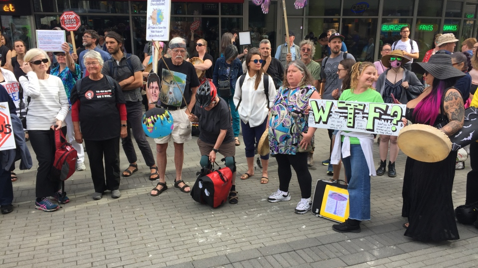 Anti-pipeline protesters are seen in downtown Vancouver on June 18, 2019.