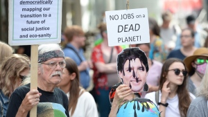 Protesters take part in a pipeline expansion demonstration in downtown Vancouver on Tuesday June 18, 2019.  (Jonathan Hayward / THE CANADIAN PRESS)