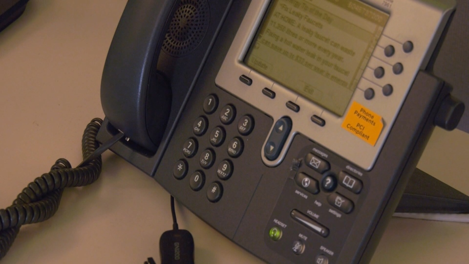 A phone is seen at Vancouver's 311 Contact Centre on June 18, 2019.