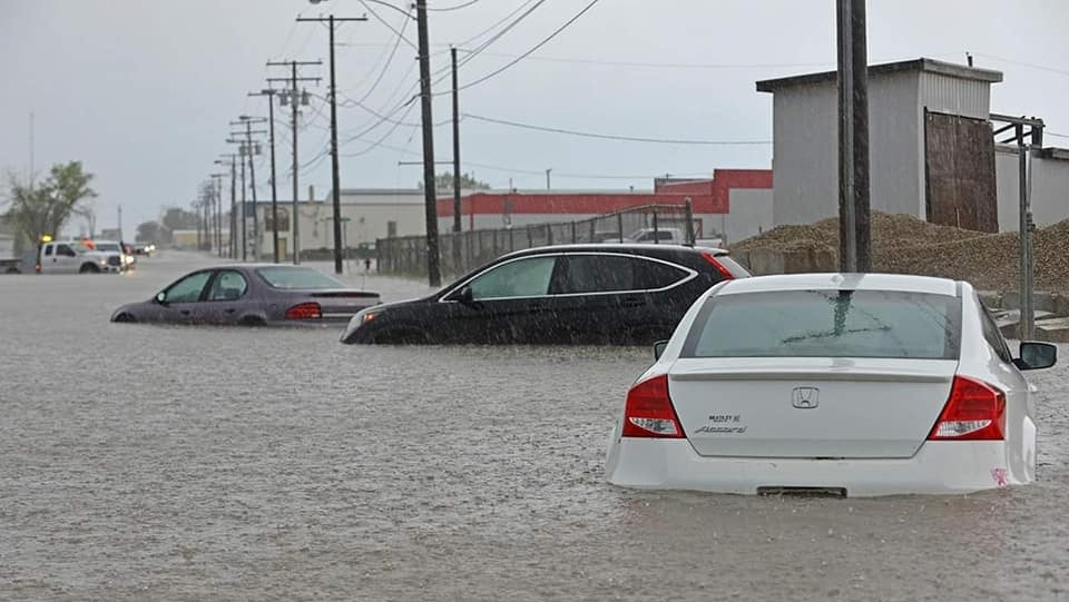 Three submerged vehicles are seen in Swift Current following a flash flood on June 18, 2019. (Courtesy: Bruce Theise)