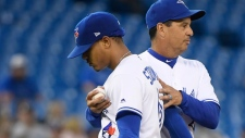 Toronto Blue Jays manager, right, Charlie Montoyo takes starting pitcher Marcus Stroman (6) out of the game during eighth inning MLB American League baseball action in Toronto on Tuesday June 18, 2019. THE CANADIAN PRESS/Nathan Denette