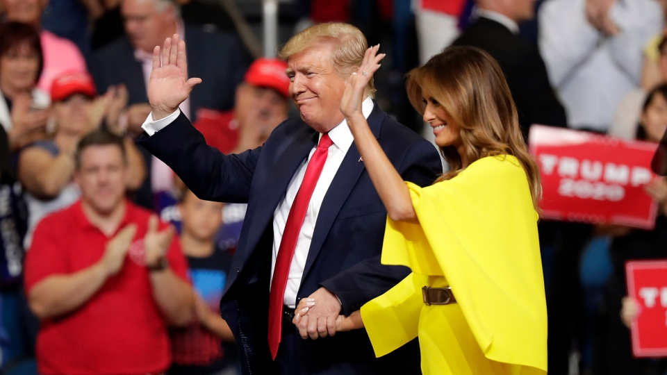 U.S. President Donald Trump and first lady Melania Trump greet supporters at a rally where the president formally announced his 2020 re-election bid Tuesday, June 18, 2019, in Orlando, Fla. (AP Photo/John Raoux)