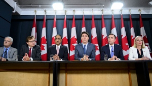 Prime Minister Justin Trudeau makes an announcement and holds a media availability regarding the government's decision on the TransMountain Expansion Project with Minister of Environment and Climate Change Catherine McKenna, right to left, Minister of Finance Bill Morneau, Minister of Natural Resources Amarjeet Sohi, Minister of Fisheries, Oceans and the Canadian Coast Guard Jonathan Wilkinson and Minister of Transport Marc Garneau in Ottawa on Tuesday, June 18, 2019. (THE CANADIAN PRESS / Sean Kilpatrick)