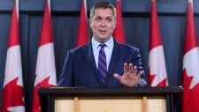 Conservative Leader Andrew Scheer reacts to Prime Minister Justin Trudeau's announcement regarding the government's decision on the TransMountain Expansion Project in Ottawa on Tuesday, June 18, 2019. THE CANADIAN PRESS / Sean Kilpatrick