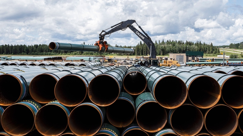 Pipe for the Trans Mountain pipeline is unloaded in Edson, Alta. on Tuesday June 18, 2019. THE CANADIAN PRESS / Jason Franson