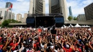 Thousands of fans cheers at Toronto City Hall during the 2019 Toronto Raptors Championship parade in Toronto, on Monday, June 17, 2019. THE CANADIAN PRESS / Nathan Denette