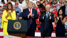 First lady Melania Trump, U.S. President Donald Trump, Vice President Mike Pence and Karen Pence greet supporters at a rally where Trump formally announced his 2020 re-election bid Tuesday, June 18, 2019, in Orlando, Fla. (AP / John Raoux)