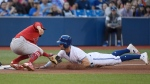 Los Angeles Angels shortstop David Fletcher (6) tags out Toronto Blue Jays left fielder Randal Grichuk (15) during fifth inning MLB American League baseball action in Toronto on Tuesday June 18, 2019. THE CANADIAN PRESS/Nathan Denette