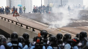 Police are facing questions about their use of tear gas and steel batons in dealing with protests in Hong Kong. (Vincent Yu/The Associated Press)