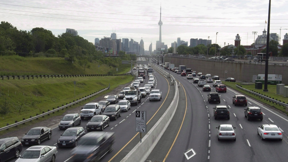 Vehicles travel along in Toronto on Monday, June 29, 2015. THE CANADIAN PRESS/Frank Gunn