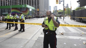 Police stand in a cordoned off area of Queen and Bay streets in Toronto on June 17, 2019. (Chris Young / THE CANADIAN PRESS)