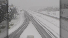 DriveBC highway camera shows snowy conditions along the Okanagan Connector at around 8:30 Wednesday morning. (DriveBC photo)