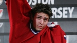 Carey Price of Vancouver tries on his Montreal Canadiens jersey during the first round at the NHL entry draft in Ottawa Saturday, July 30, 2005. It sounds strange today, but when the Canadiens chose Price fifth overall in the 2005 draft, many observers were surprised. (THE CANADIAN PRESS/Jonathan Hayward)