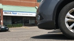 A car is seen at an examination centre near Lawrence Avenue and Victoria Park. (Phil Fraboni/CTV News Toronto)