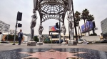 "A pedestrian walks past the ""Four Ladies of Hollywood"" gazebo on Hollywood Boulevard in Los Angeles, on Wednesday June 19, 2019. (AP Photo/Richard Vogel)"