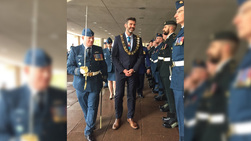 Edmonton Mayor Don Iveson participates in a ceremony honouring the 408 Tactical Helicopter Squadron. (Source: @YEGMayorOffice)