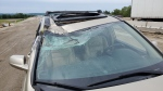 An SUV sustained major damage after a transport truck's wheel separated and smashed into it on Wed., June 19, 2019 (OPP Sgt. Kerry Schmidt/Twitter)