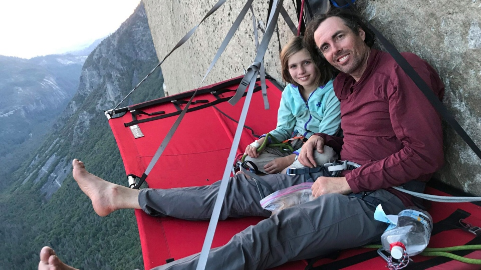 Michael Schneiter poses with his daughter, Selah Schneiter, during her climb up El Capitan in Yosemite National Park, Calif. (Michael Schneiter via AP)