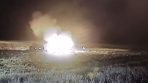 Dashcam footage shows Terrence Morin setting himself and a stolen vehicle on fire while police looked on. (Courtesy RCMP)
