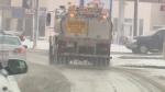 Calcium chloride de-icer is applied to an Edmonton street.