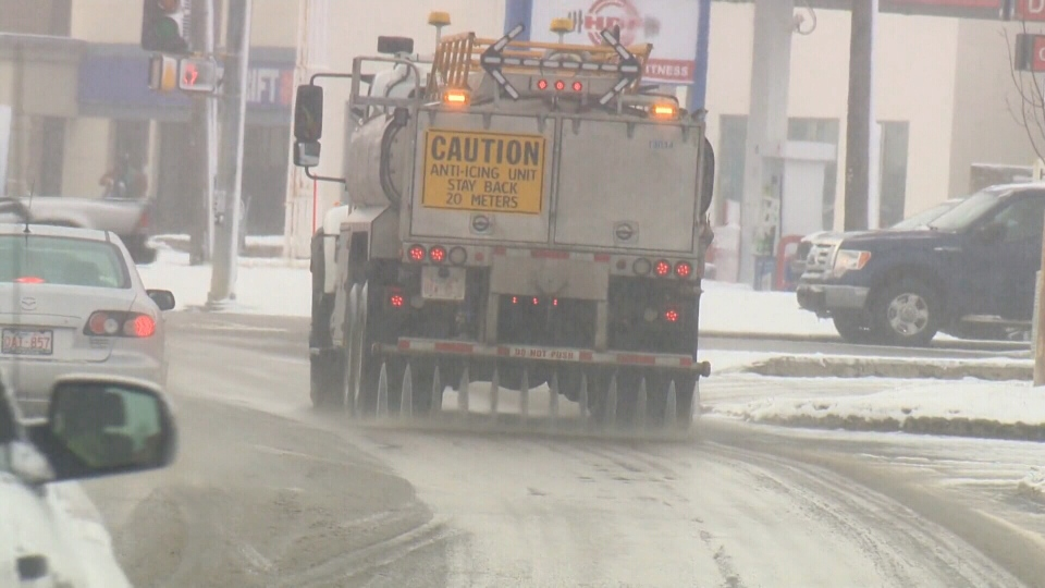 Calcium chloride de-icer is applied to an Edmonton street.