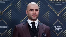 Mark Giordano of the Calgary Flames poses on the red carpet before the NHL Awards, Wednesday, June 19, 2019, in Las Vegas. (AP Photo/John Locher)