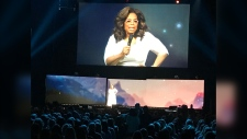 Oprah WInfrey addresses her loyal fans during her appearance at the Scotiabank Saddledome on Wednesday night