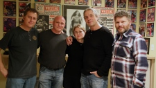 Canadian-American retired professional wrestler Bret Hart, second from right, poses with, left to right, Regan Enderl, Fulvio Cecere, Collette Ehrich and Martin Cairns, in Calgary, in this undated handout photo. (THE CANADIAN PRESS / HO, Fulvio Cecere)