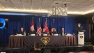 Ontario Provincial Police are seen during a press conference to announce the result of a years-long investigation into a child pornography operation. (Kenneth Dishman)