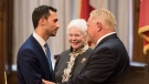 Ontario Premier Doug Ford shakes hands with Stephen Lecce after he is sworn into his role as Ontario's Minister of Education at Queen's Park in Toronto on Thursday, June 20, 2019. THE CANADIAN PRESS/ Tijana Martin