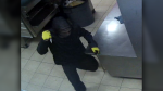 A suspect was caught on camera during an armed robbery at a Penticton, B.C. pizzeria on June 14, 2019. (Handout)