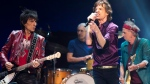 The Rolling Stones' Mick Jagger (centre), Keith Richards (right), Charlie Watts (back) and Ronnie Wood (left) perform during a concert in Toronto on Saturday May 25, 2013. All things considered, guitarist Ronnie Wood says the Rolling Stones count themselves pretty fortunate these days. (THE CANADIAN PRESS/Frank Gunn)