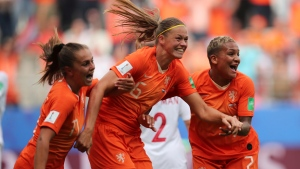 Netherlands' Anouk Dekker, center, celebrates after scoring the opening goal with teammates during the Women's World Cup Group E soccer match between the Netherlands and Canada at Stade Auguste-Delaune in Reims, France, Thursday, June 20, 2019. (AP Photo/Francisco Seco)